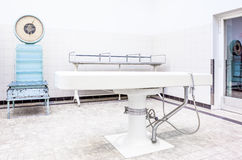 Autopsy tables in morgue. Autopsy antique tables in the morgue in clinic Royalty Free Stock Photo