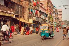 Autorickshaw in indian style driving through busy city street Stock Photography