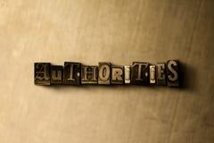 AUTORIDADES - close-up vintage sujo da palavra typeset no contexto do metal ilustração stock