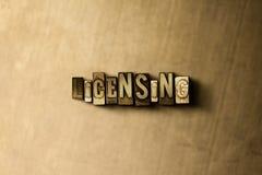 AUTORIZZAZIONE - il primo piano dell'annata grungy ha composto la parola sul contesto del metallo fotografia stock