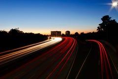 Autoroute nationale au coucher du soleil Photos stock