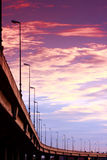 Autoroute sous le coucher du soleil Photos libres de droits