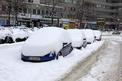 Autos are covered with a snow parked on the street Royalty Free Stock Image