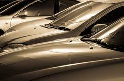 Autos in der goldenen Farbe Lizenzfreies Stockfoto