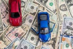 Autos mit Dollar Stockfotografie