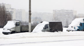 The autos under snow. On the moscower street Stock Photography