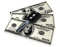 Autoschlüssel und 100 Dollar Stockfoto