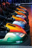 Autoscooter. Colourful bumper cars standing in a line Royalty Free Stock Photo