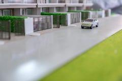 Autospielzeug auf der Straße Stockbild