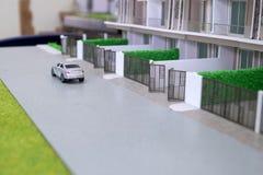 Autostuk speelgoed op de weg Stock Afbeeldingen