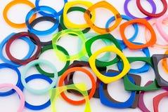 Autour de et anneaux carrés de plastique de forme Images stock