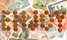 autour du monde de devises de pièces de monnaie Image stock