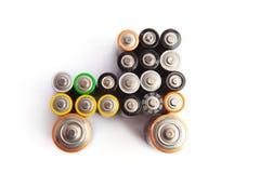 Autovorm van gebruikte die aa-batterijen wordt op wit worden geïsoleerd gemaakt dat Stock Foto