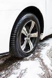 Autowasseretteconcept - autowiel en schuim Stock Foto