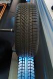 Autowiel met blauw licht Stock Afbeelding