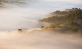 Morning fog in autumn over hills Royalty Free Stock Image