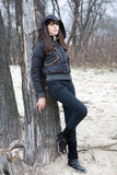 Autumn. The portrain woman with long hair in black coat Royalty Free Stock Photography
