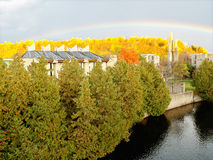 Autumn. Sunrise on the river with rainbow after thunderstorm Stock Photography