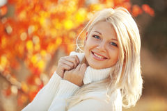 Autumn. Portrait of beautiful young woman walking outdoors in autumn royalty free stock photography
