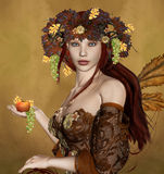 Autumn. Beautiful woman with an apple and some autumnal symbols Stock Photo