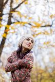 Autumn. Young woman in the autumn forest royalty free stock photo