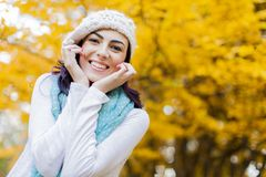 Autumn. Happy young woman in the autumn forest stock image
