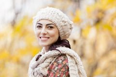 Autumn. Pretty young woman at the autumn forest royalty free stock image