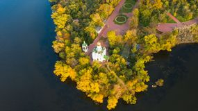 Autumn aerial top view of Christian Church on Monastic island in. Beautiful autumn panoramic aerial view of Christian Church on Monastic island on Dnieper river royalty free stock images