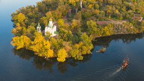 Autumn aerial view of Christian Church on Monastic island on Dnieper river in Dnipro city. Beautiful autumn panoramic aerial view of Christian Church on royalty free stock photography