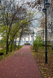 Autumn alley with lanterns and rotunda Stock Photography