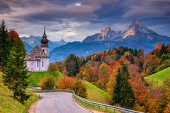 Autumn in Alps. Image of the Bavarian Alps with Maria Gern Church and Watzmann mountain during beautiful autumn sunrise royalty free stock photo