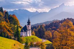 Autumn in Alps. Image of the Bavarian Alps with Maria Gern Church and Watzmann mountain during beautiful autumn sunset stock photography