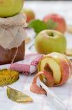 Autumn apple jam. A jam-jar, a whole apple, apple jam on a background of warm autumn weather stock images