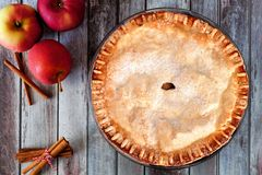 Autumn apple pie, overhead table scene over rustic wood Stock Image