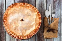 Autumn apple pie, overhead table setting on rustic wood background Stock Photos