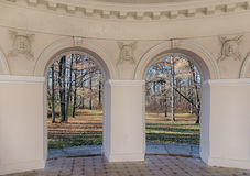 Autumn arch. View at the autumn park through the arch of the pavilion Stock Photography