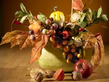Autumn arrangement. Plased at yellow pumpkin, lot of autumn warm beads and colours Royalty Free Stock Image