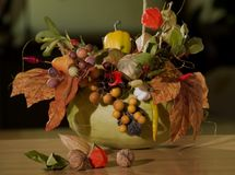 Autumn arrangement 2. Autumn arrangement plased at yellow pumpkin, lot of autumn warm beads and colours Royalty Free Stock Photos