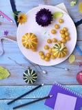 Autumn arrangement of decorative pumpkins, fresh flowers, leaves and art materials royalty free stock photos