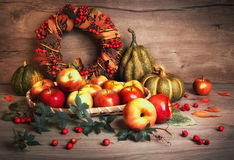 Autumn arrangement with tasty apples, pumpkins and decorations Royalty Free Stock Images