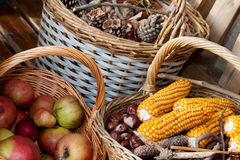 Autumn atmosphere. Autumn decorated baskets on a bench Stock Photo