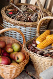 Autumn atmosphere. Autumn decorated baskets on a bench Royalty Free Stock Photos