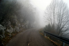 Autumn atmosphere. Fog on a deserted highway Royalty Free Stock Photo