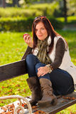 Autumn attractive woman eat apple sunset park Royalty Free Stock Photo