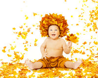 Autumn Baby, Little Kid sitting Fall Leaves, Yellow Child Boy. Autumn Baby, Little Kid sitting in Fall Leaves, Child Boy in Yellow Crown with Maple Leaf royalty free stock image