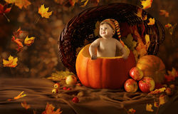 Autumn Baby Pumpkin. Little Kid Artistic Portrait Royalty Free Stock Photography