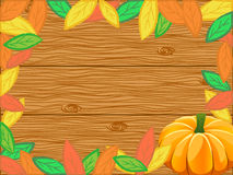 Autumn background. Composition made of autumn leaves and pumpkin over the wooden backdrop Royalty Free Stock Photos