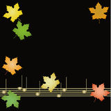 Autumn background. With colorful leaves of maple and musical noles Royalty Free Stock Photo