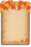Autumn background with colored leaves on old paper Royalty Free Stock Images