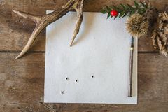 Autumn background with deer antlers. Deer antler, chesnut, dry leaf, vintage pen and back view of old shooted target on the old wooden planks stock photo